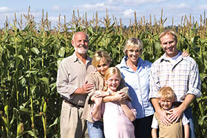 farm family in cornfield